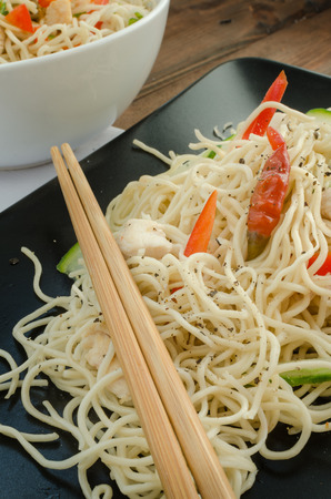 Chinese noodles, fast but delicious food with chopsticks photo