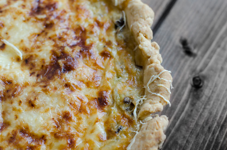 French quiche with onion, leek and mushrooms, homemade photo