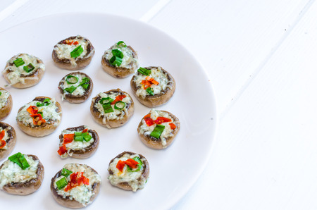 Baked muhrooms with blue cheese, red pepper and spring onion, bio product home photo