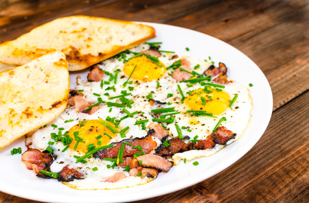 Bacon, eggs and chive with crispy toast, bio product photo