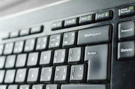 dvd room: Keyboard with enter button, with light from left side Stock Photo