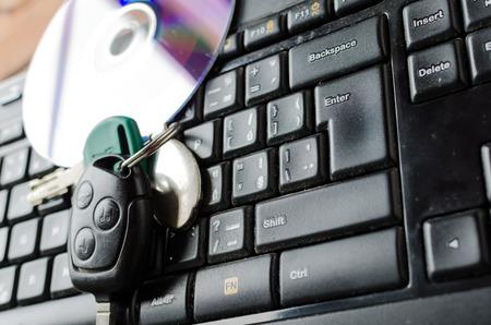 shiny car: Keyboard with CD, CD half copy and shiny and keys from car Stock Photo