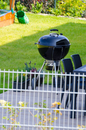 garden green: Grill on garden, green cutted grass, shiny day Stock Photo