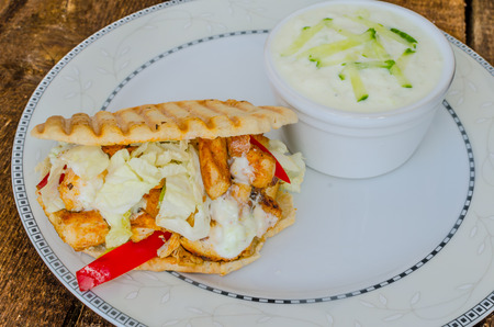 tzatziki: Greeg gyros with tzatziki on wood board