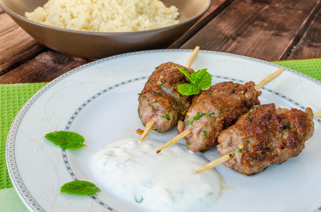 non vegetarian: Beef kebab with coriander, garlic, couscous and mint dip Stock Photo