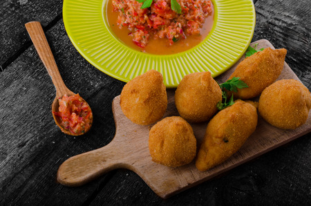 Street food is popular the world over, but the Brazilians is the best.Creamy chicken filling coated in a chicken dough then breadcrumbs - fried perfect and hot tomato salsa photo