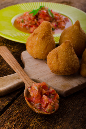 Street food is popular the world over, but the Brazilians is the best.Creamy chicken filling coated in a chicken dough then breadcrumbs - fried perfect and hot tomato salsa