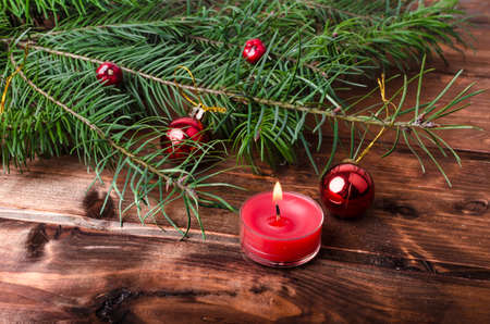 Christmas candle with pine needles on wood table photo