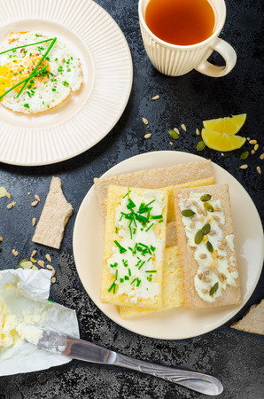 galettes: Crisp Crispbread with curd cheese spread with chives and seeds, fried egg and morning tea