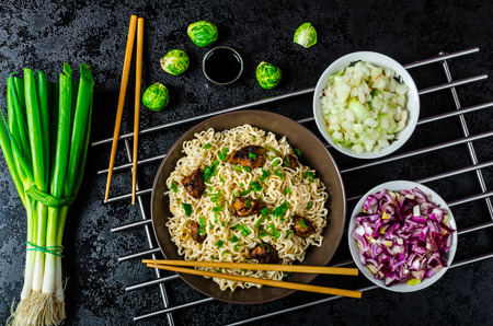 Asian chicken noodles salad, fresh onions, sprouts and spring onions