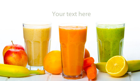 Smoothie Day, time for health - apple-banana, carrot-orange and lemon organic with herbs