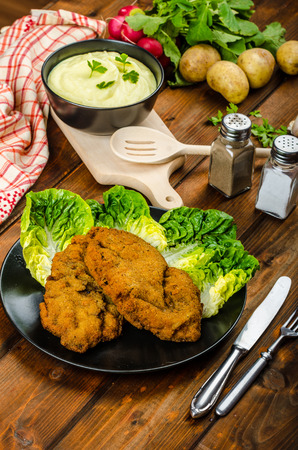 Wiener Schnitzel with mashed potato, veal meal, original and delicious photo