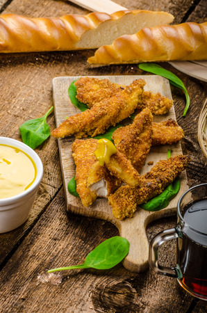 tenders: Corn crusted Chicken Tenders with spinach and toast, honey-dijon mustard dip, homemade bread baguette