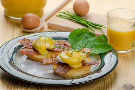 Eggs bvenedict with chives and fresh juice, spinach leaves, bio eggs photo