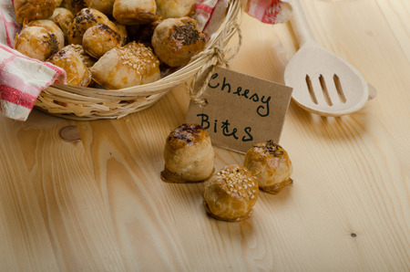 cheesy: Cheesy bites with seeds, wine in wicker basket, nice gift