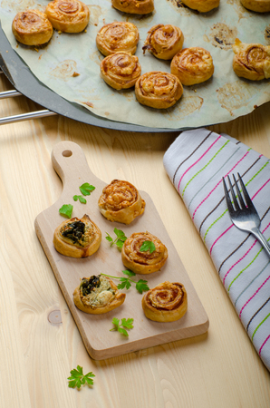 Canap�s puff pastry with spinach, garlic blue cheese, easy snack photo