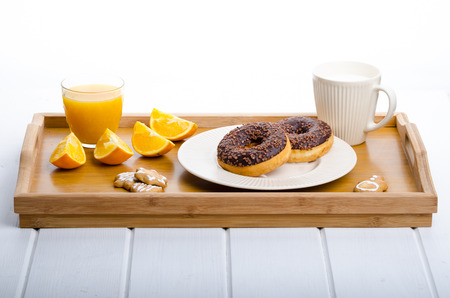 Breakfast tray donut orange and milk, christmas cookies photo