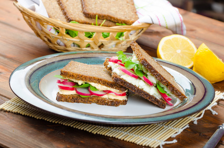 clarified: Healthy snack - wholemeal bread with egg-cream spread and fresh vegetable arugula and radishes