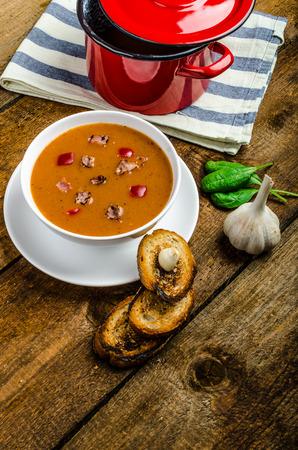 Goulash soup with crispy garlic toast, homemade on wood table photo