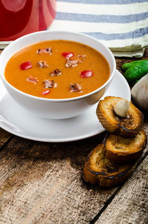 Goulash soup with crispy garlic toast, homemade on wood table photo