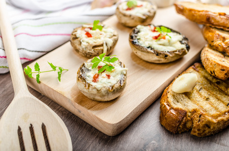 Grilled mushrooms stuffed with blue cheese and chilli and garlic toast Stock fotó