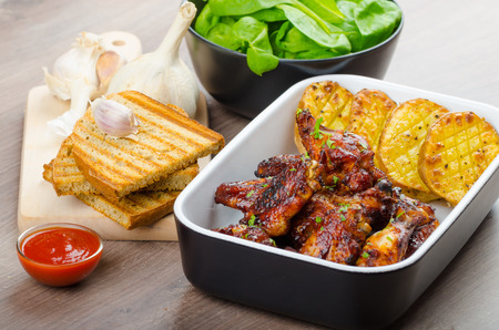 sweet mustard: Sticky chicken wings with garlic bread panini, rustic spicy potatoes, fresh spinach leaves