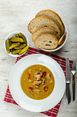 piri piri: Pork stew and homemade bread and pickles, piri piri peppers hot goulash