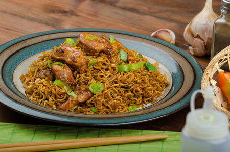 Chinese noodles with chicken and onion, peppers and soy photo