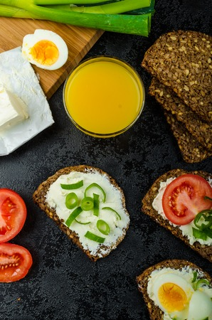 spring onions: Healthy snack, whole wheat bread with cream cheese bio, tomato, spring onions and boiled egg