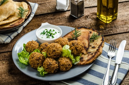 heathy diet: Health crunchy falafel with mint and garlic dip, naan bread with cumin and herbs