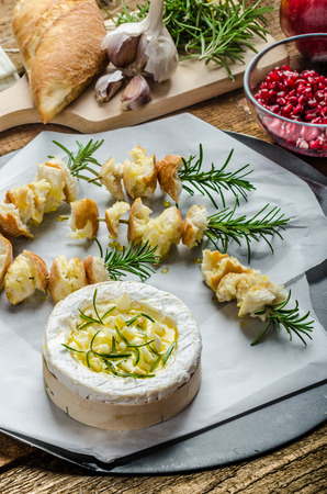 Prepareing for Baked Camembert with Garlic & Rosemary, with toast baked on rosemary stalk, fresh pomegranate, just DIP IN!