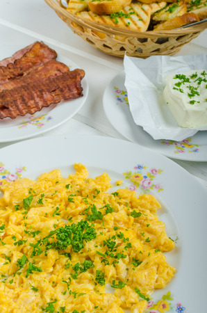 hearty: A hearty breakfast of eggs, bacon, sausage and toasted baguette and fresh curd