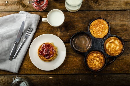 homemade style: Pancakes in retro style, wood board, old griddles, bio milk homemade jam Stock Photo