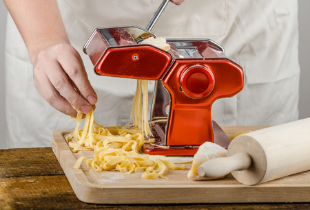 rollingpin: Chef production pasta -  Italian pasta grinder, wood board, rolling-pin, all made from semolina flour