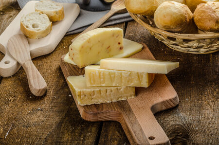 cheese knife: Delicious ripe cheese with crispy baguette and wine, wood board Stock Photo