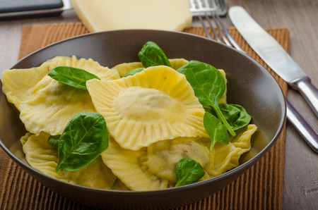 Homemade ravioli stuffed with spinach and ricotta, all home prepared photo