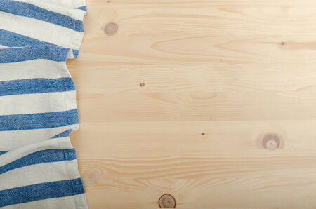 advertisment: Kitchen cloth on wood background, advertisment place Stock Photo