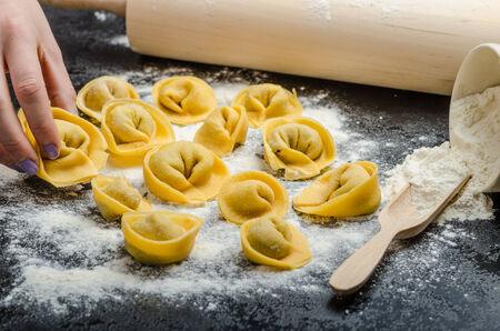 stuffed tortellini: homemade pasta tortellini stuffed mushrooms, garlic and cheese, from real semolina flour from Italy