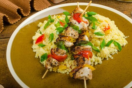 Couscous with vegetables and spring onion, chicken skewer with peppers Reklamní fotografie