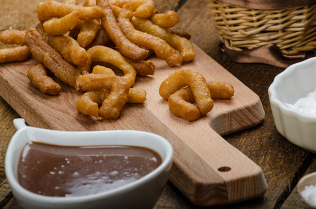 Churros with chocolate dip - Streed food, deep fried, delicious, but heavy street food. photo