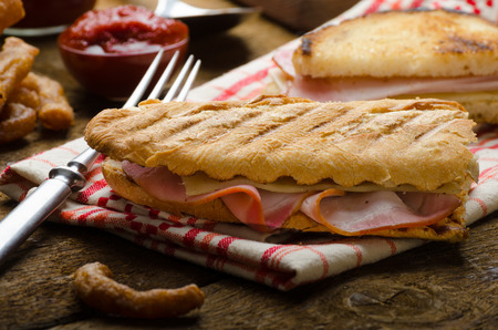 Quick dinner, toast with ham and cheese - panini, english toast, french with butter, dessert delicious churros