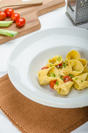 semolina pasta: Homemade tortellini from semolina flour, stuffed with Parmesan cheese and tomatoes