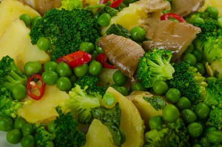 Healthy sping salad with Super Greens, broccoli, peas, pork and potato
