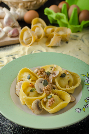 buttery: Tortellini stuffed mushrooms, parmesan cheese and organic garlic, sprinkled with seeds and nuts, topped with buttery reduction
