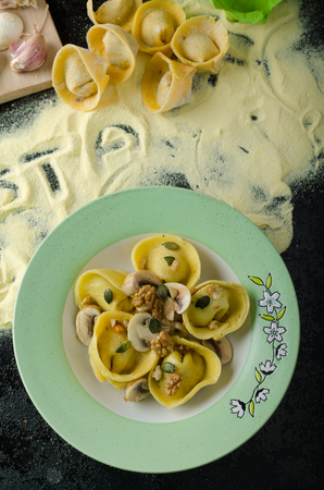 Tortellini stuffed mushrooms, parmesan cheese and organic garlic, sprinkled with seeds and nuts, topped with buttery reduction photo