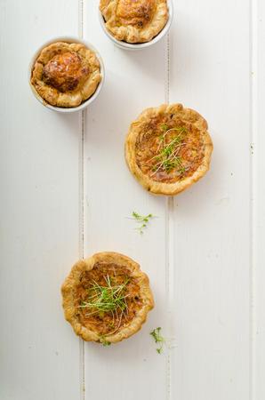 grow up: Onion mini quiche with bacon and corn, sprinkled bio microgreens, home grow up, organic