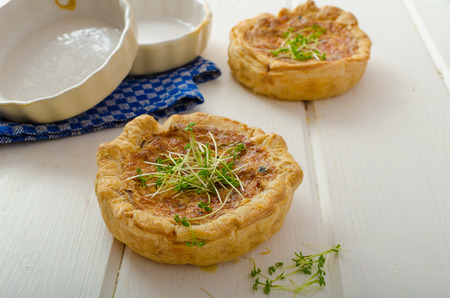 Onion mini quiche with bacon and corn, sprinkled bio microgreens, home grow up, organic