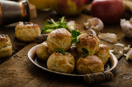 danish puff pastry: Cheese mini buns from home dough, sprinkled with sesame seeds, poppy and caraway seeds, orange juice, fresh apple and herbs on top