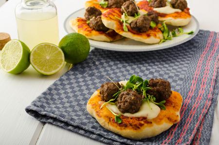 mini pizza: Mini pizza with meatballs, lime juice - fresh, microgreens on top, organic food, beef meat