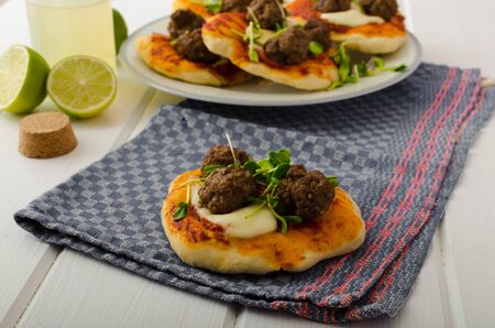 mini pizza: Mini pizza with meatballs, lime juice - fresh, microgreens on top, organic food, beef meat